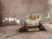 Miniature ship in bottle.