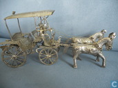 miniature man with 2 horses and wagon