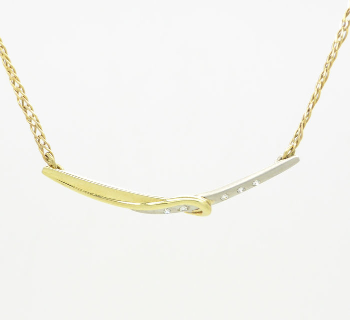 14 carat bicolour gold necklace set with 0 10 ct in