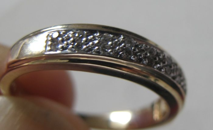 14 karat yellow gold ring set with 16 diamonds Catawiki