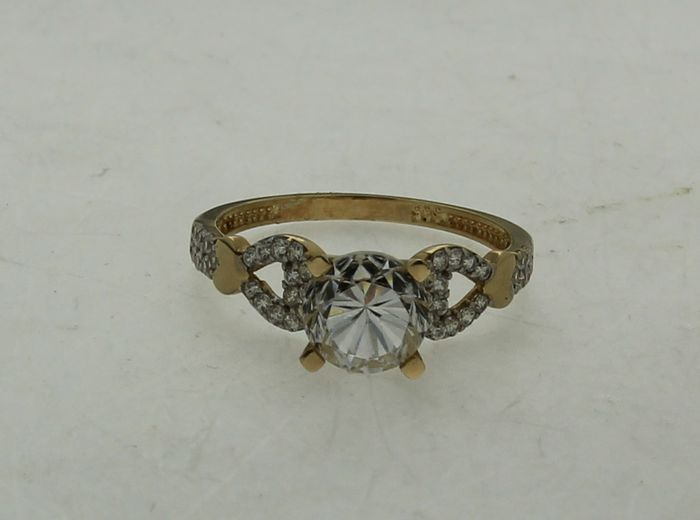 Gold solitaire ring with decorations on the sides catawiki for 5 golden rings decorations