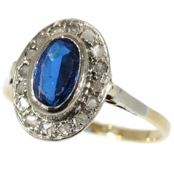 Gold ring with oval sapphire surrounded with rose diamond ...