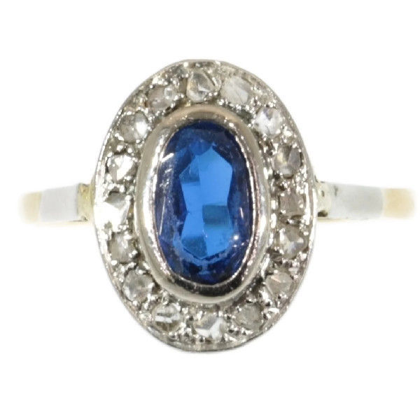 Gold ring with oval sapphire surrounded with diamond ...