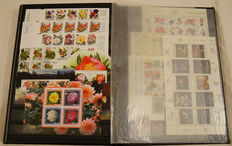 Topical stamps - Extensive collection in 3 stock books including sports, flora and fauna and transport