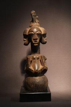 A protective statue with four heads of the SONGYE tribe in Congo.
