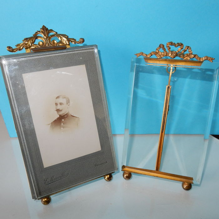 two gilded bronze picture frames with biseaute cut glass