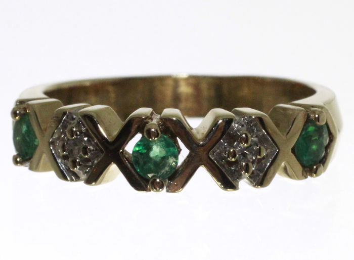 10k channel ring with emerald and catawiki