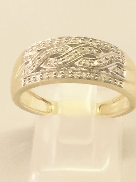 braided white and yellow gold ring with diamonds