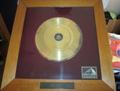 Check out our Gold Record Award Johnny Jordaan 1964 (for 25 years of succes)