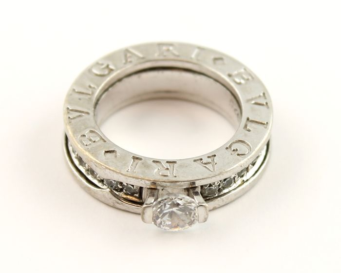silver ring by bvlgari with 1x 0 5 and 27x0 02 carat
