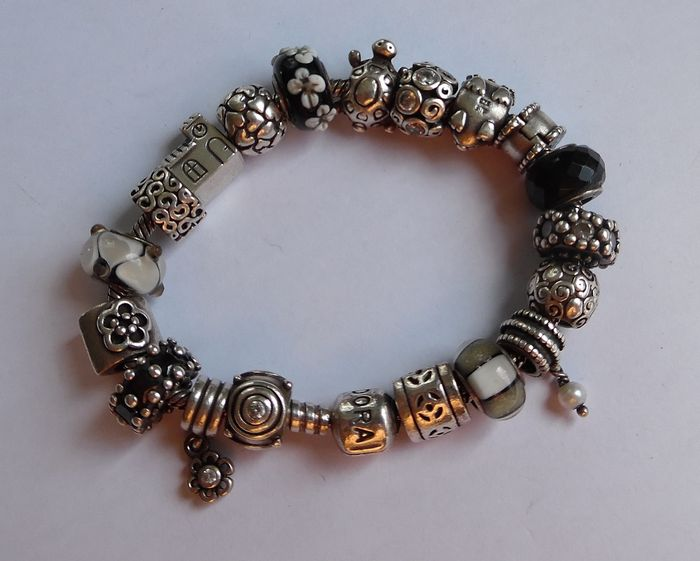 pandora bracelet with 17 charms and 2 stoppers catawiki