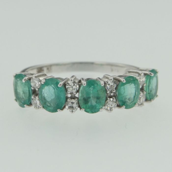 white gold channel ring with emerald and octagon cut