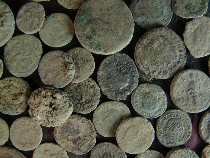 Roman empire 50 pieces of bronze coins found in the for Things found in soil