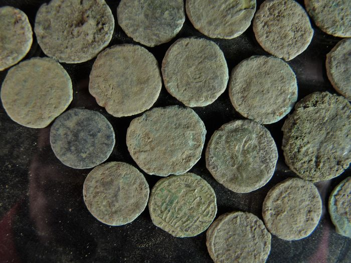 Roman empire 50 pieces of bronze coins found in soil for Things found in soil
