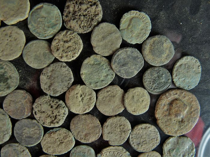 Roman empire 50 pieces bronze coins found in soil for Things found in soil