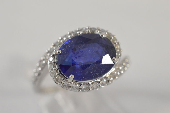 white gold ring with a large sapphire surrounded