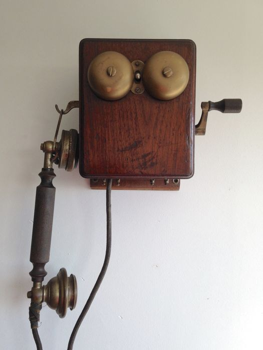 Partial wooden phone with sling hanging