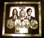 Check out our Nirvana With The Lights Out platinum award.