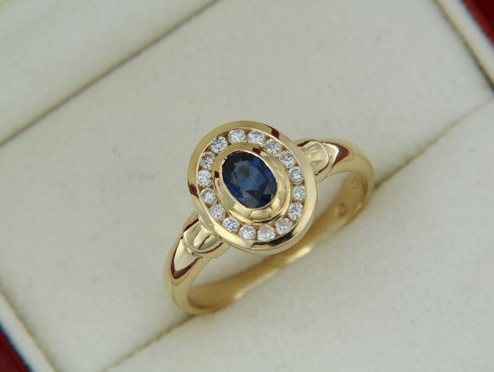 ring with a sapphire in the center surrounded with