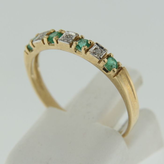 yellow gold channel ring with octagon cut and