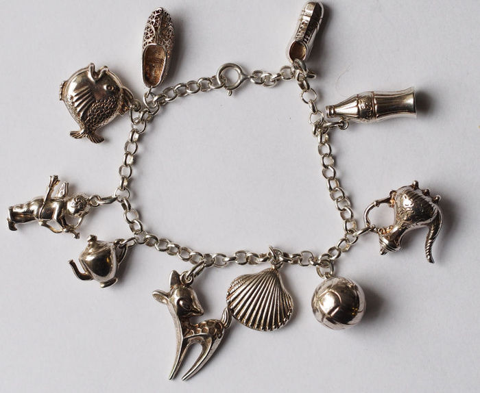 silver charm bracelet with 10 different charms catawiki