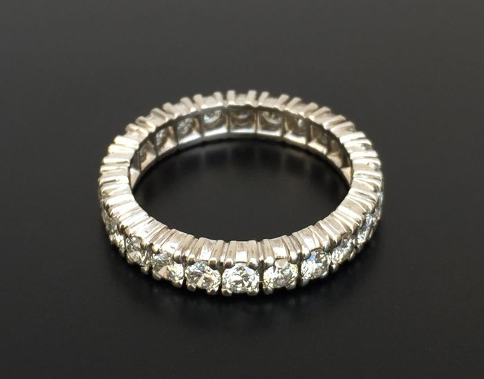 American Wedding Ring In Platinum Surrounded By Diamonds Of Top Wesselton Quality VVS Clarity Of