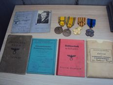 Beautiful lot with 4 Belgian medals from WWII as well as some German paper work that was found along with the medals