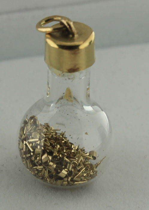 yellow gold pendant of a glass jar with gold inside catawiki
