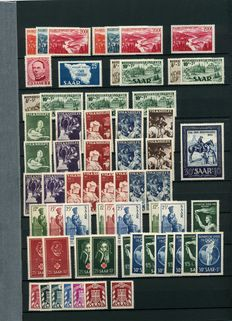 Saarland 1947/1956 - Compilation with mostly special stamps and semi-postal stamps, including multiple Volkshilfe 1951 and Official Stamps on stock cards