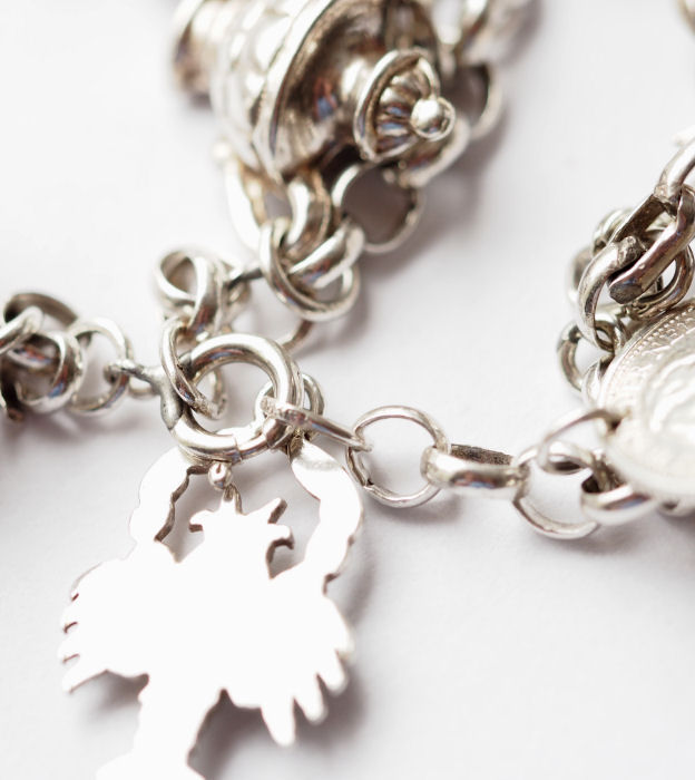 silver charm bracelet with 16 different charms catawiki