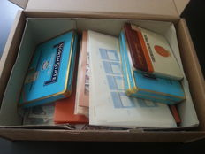 World - Batch with stamps in bags, cans, stock book and box