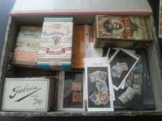 World - Batch with stamps in glassines, on cards, in tins and loose in box