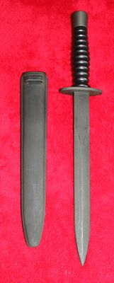 Swiss army dagger, manufacturer: Wenger, special units model, black in absolute new condition with scabbard. 20th century.