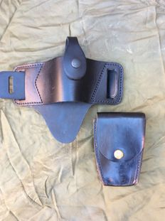 Pistol holster and hand cuff purse