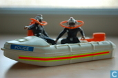 Zodiac with two police divers