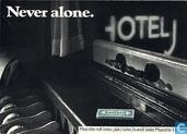 "B000017 - Mascotte ""Never alone."""