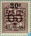 Digit on heraldic lion, with overprint