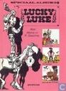 Strips - Lucky Luke - Dr. Doxey's elixir + Phil IJzerdraad + Spoorweg door de prairie