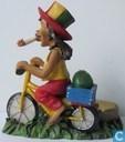 Man op gele fiets