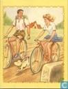 Jongen en meisje op fiets