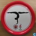 """Coca Cola Olympische Spelen 1996 metalen onderzetter """"Turnen"""" (rood)"""