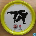 """Coca Cola Olympische Spelen 1996 metalen onderzetter """"Judo"""" (geel)"""