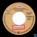 Disques vinyl et CD - Traveling Wilburys - Handle with care