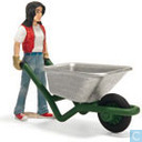 Stable girl with wheelbarrow