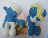 Smurf and Smurfette on tree trunk