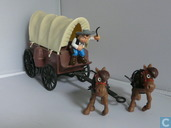 Covered wagon with horses and rider