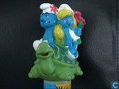 Smurf and smurfette on turtle