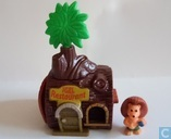 Hedgehog cottage with tree trunk