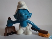 Smurf with hand broom and dustpan