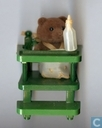 Baby bear in highchair